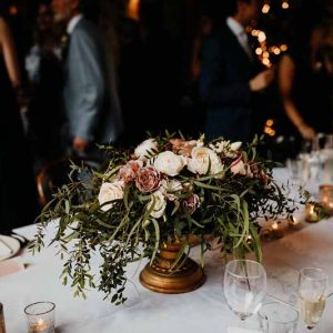 Barn wedding centrepieces not rustic