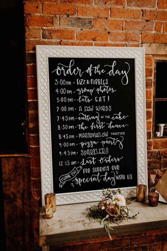 Blackboard order of the day signange Shustoke Farm Barns wedding