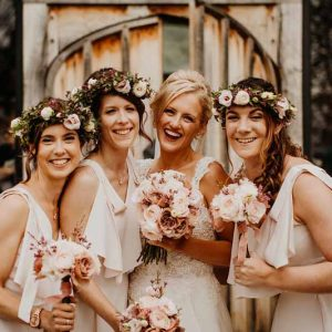 Bridesmaids flower crowns hair flowers blush pink bouquets barn wedding