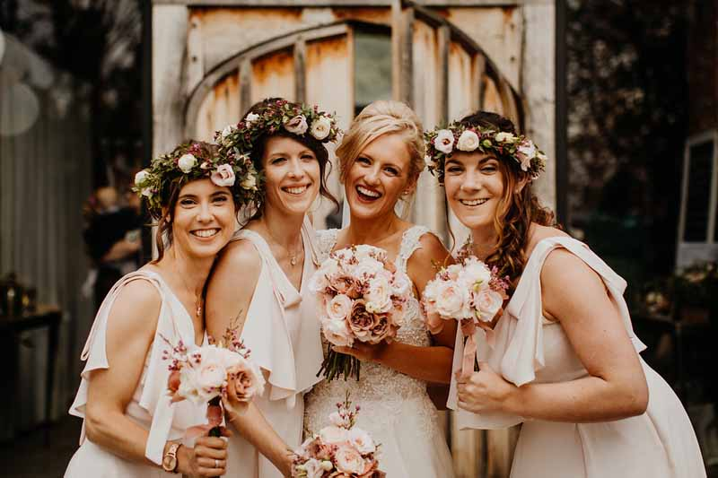 Bridesmaids flower crowns hair flowers blush pink bouquets barn wedding
