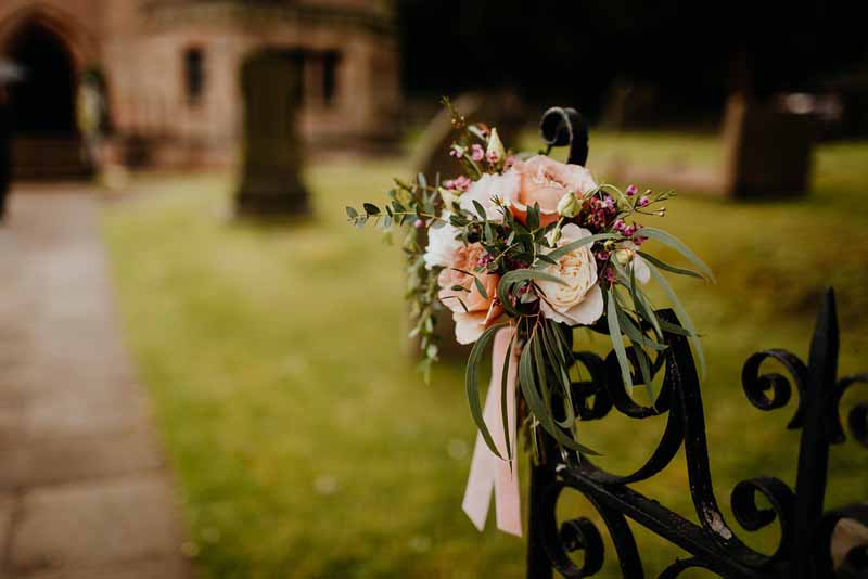 Church gate flowers Little Aston Church Wedding