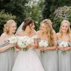 Dove Light Grey Bridesmaids Dresses with White rose ranunculus bouquets