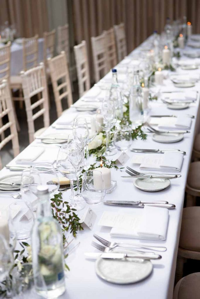 Elegant long wedding table garlands foliage and roses