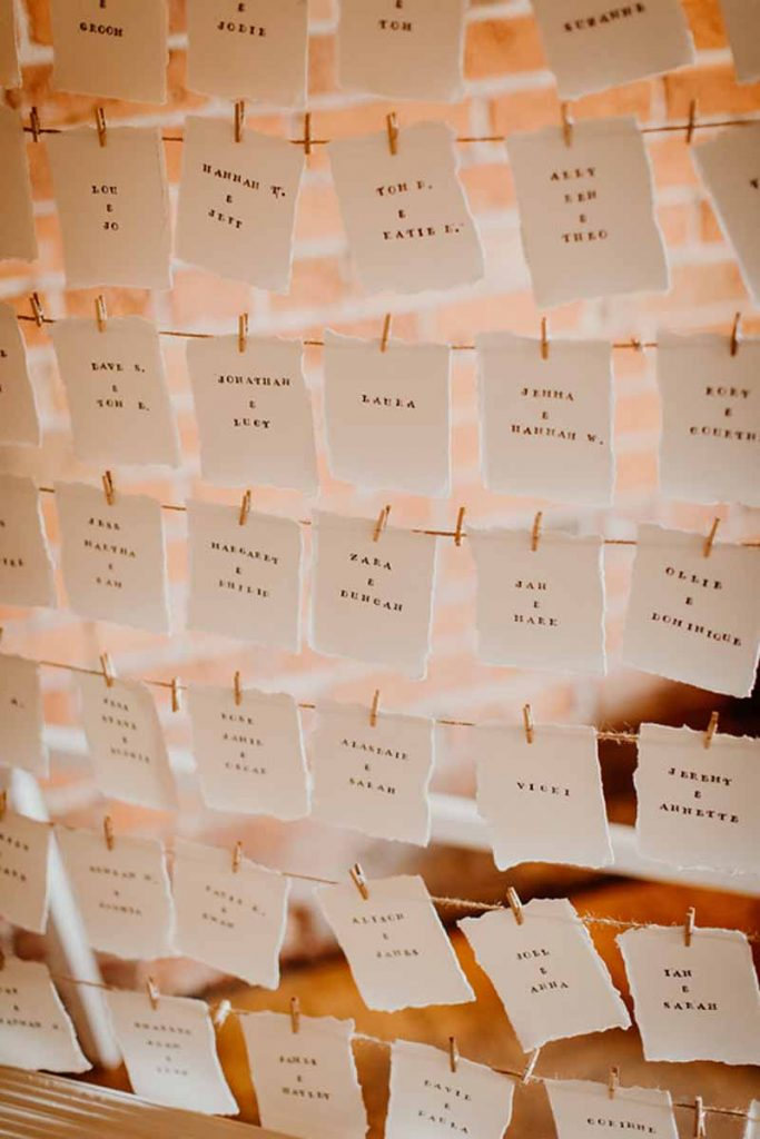 Escort cards pegged on string wedding table plan ideas