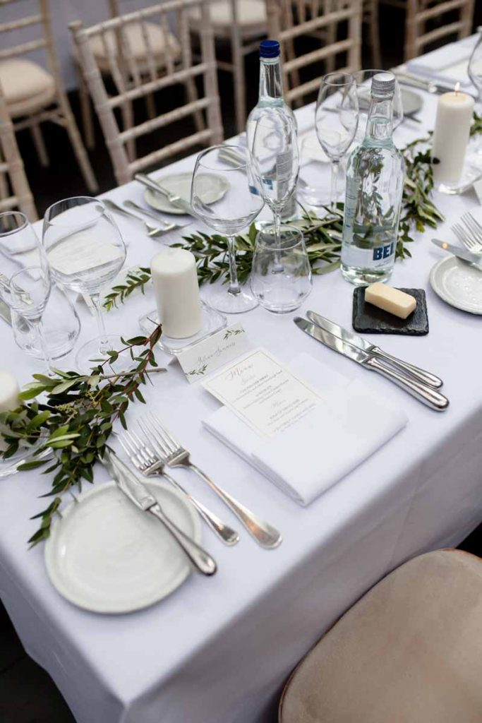 Foliage garlands long table centrepieces Hampton Manor elegant style