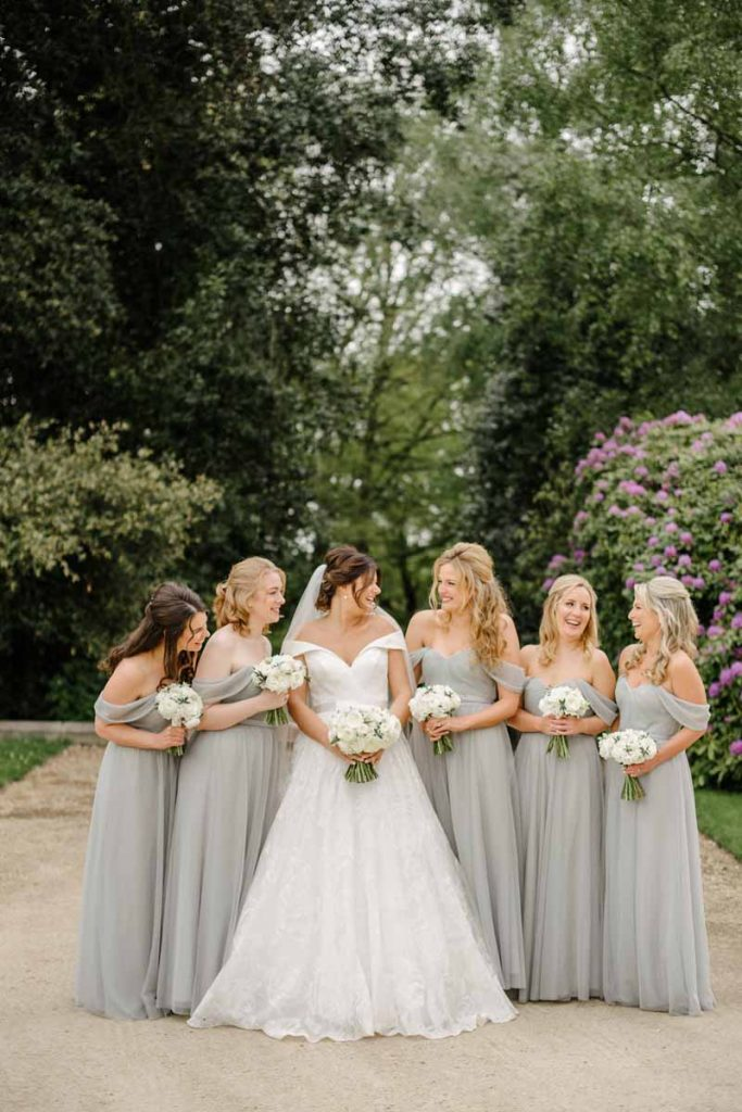 Gorgeous dove grey bridesmaids dresses white rose bouquets