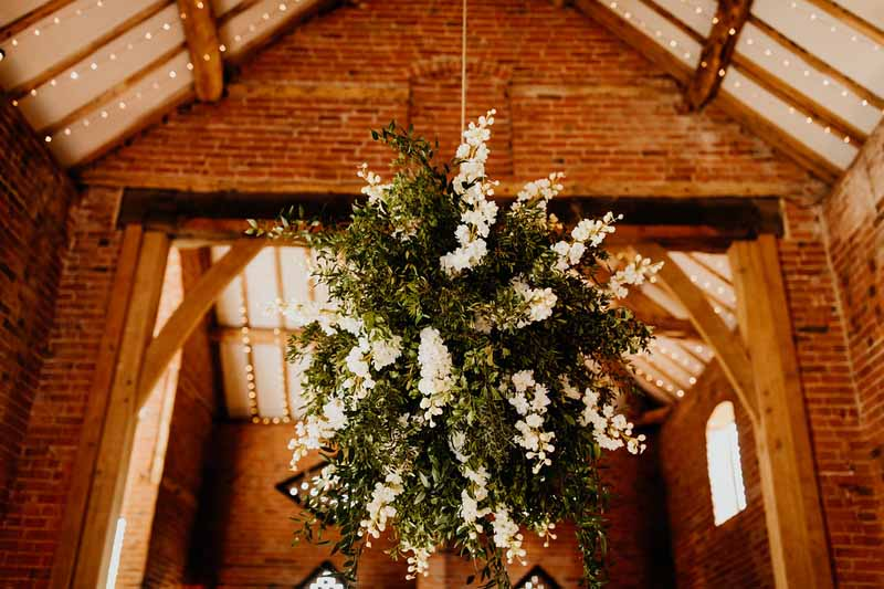 Hanging flower globes Shustoke Barns wedding florist Passion for Flowers