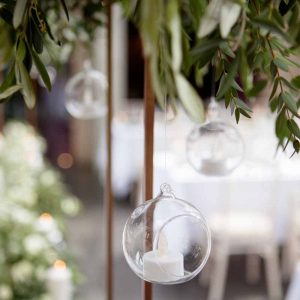 Hanging tealights from tall centrepieces
