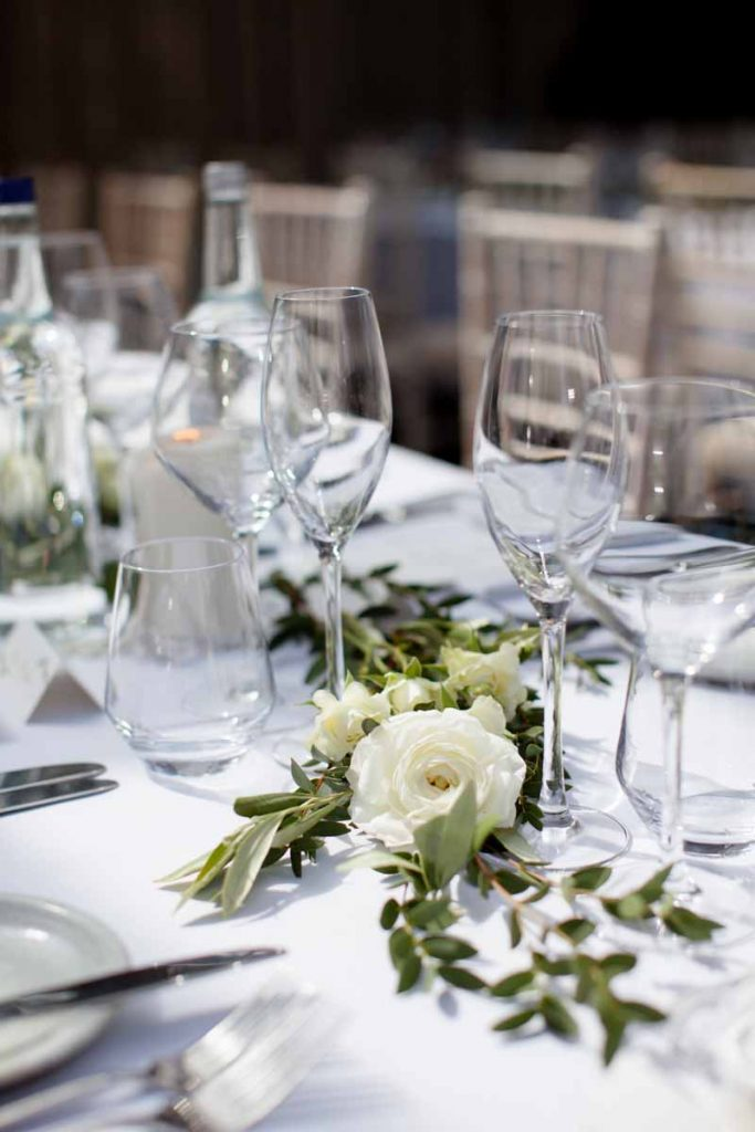 Long wedding tables garlands white green flowers Passion for Flowers at Hampton Manor
