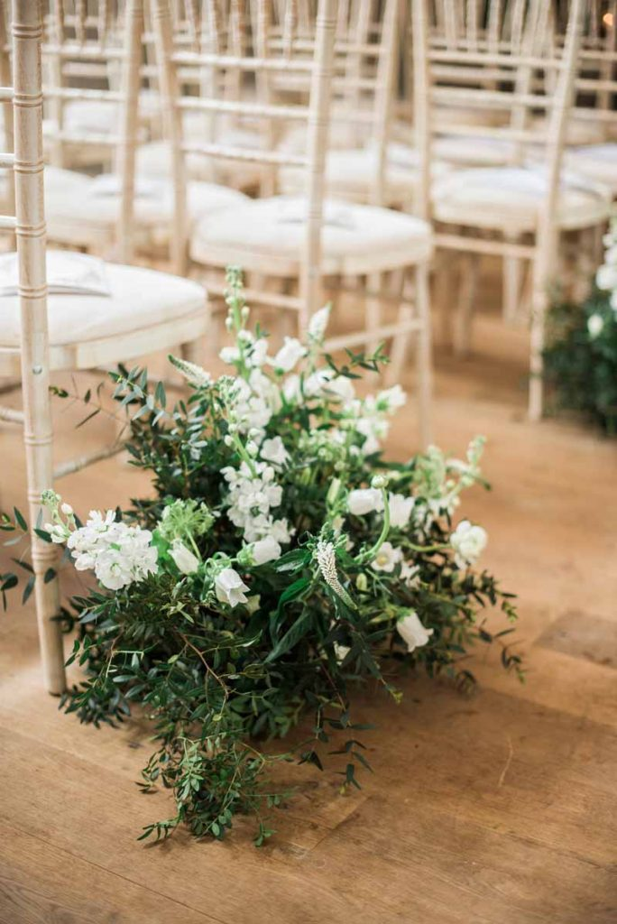 Meadow style wedding flowers aisle decorations Hampton Manor