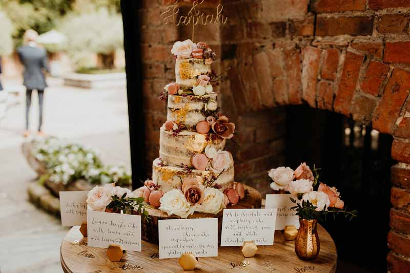 Naked wedding cake with flower decoration Shustoke Farm Barns Passion for Flowers