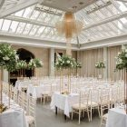 Passion for Flowers Hampton Manor wedding florist tall centrepieces