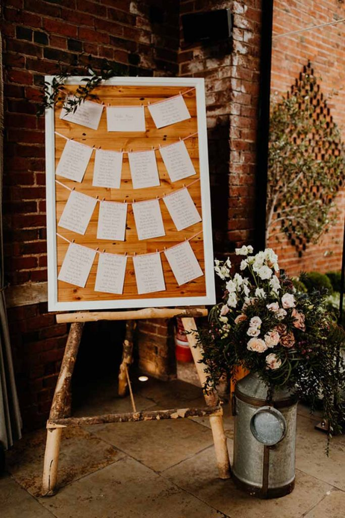Rustic wedding table plans milk churn flowers Passion for Flowers