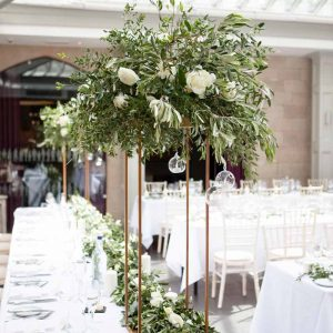 Tall floral stand wedding centrepieces top table Hampton Manor