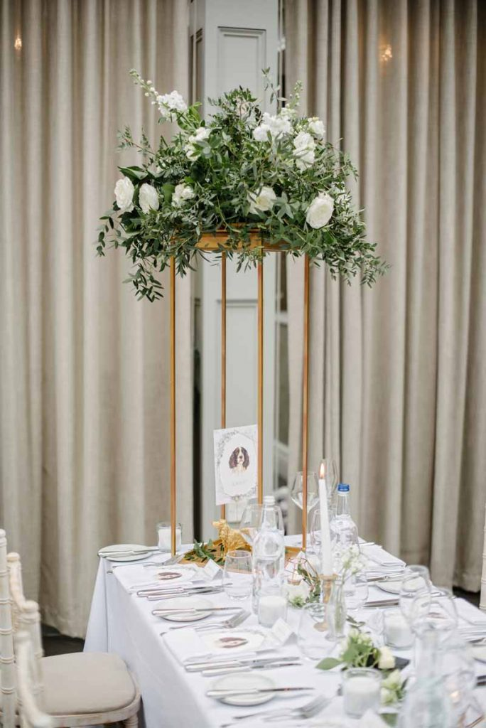 Tall gold stands wedding centrepieces