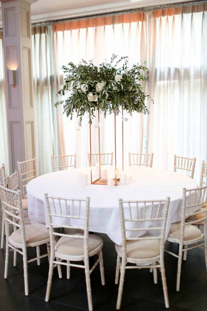 Tall wedding centrepieces floral stands white green