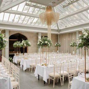Tall wedding centrepiece ideas Hampton Manor gold stands