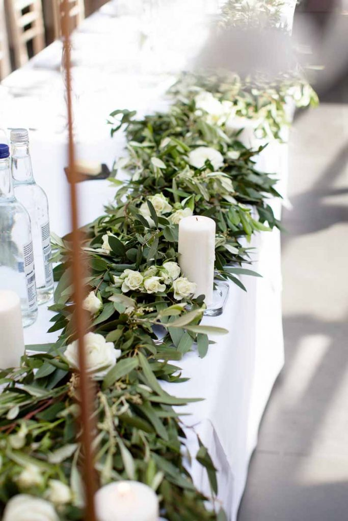 Top table garlands white green wedding flowers elegant wedding Hampton Manor