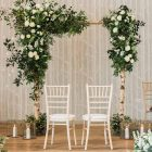 Wild white green wedding ceremony arches Hampton Manor