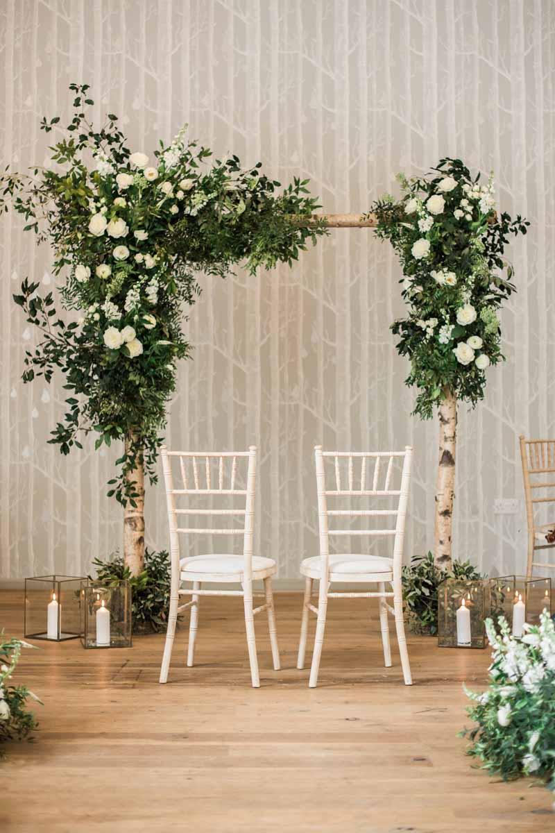 Wild white green wedding ceremony arches Hampton Manor