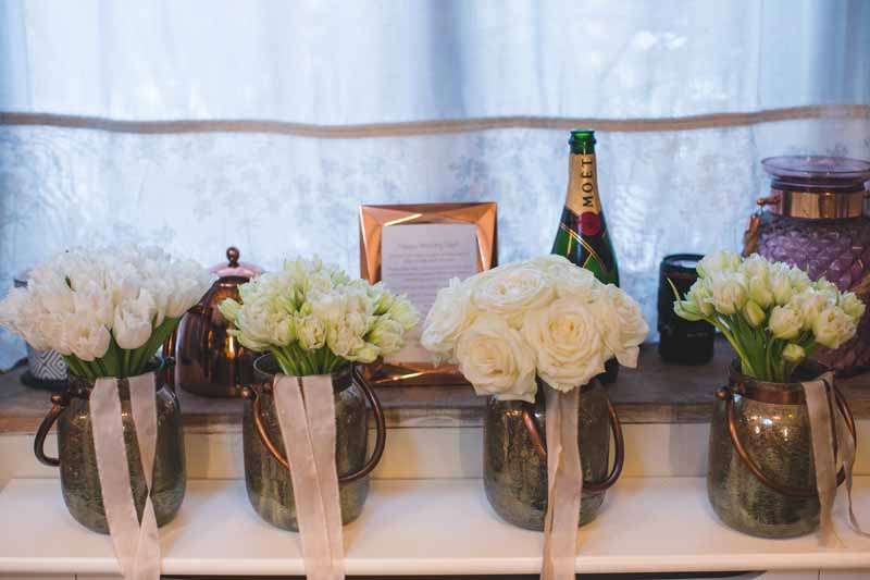 Winter bridesmaids bouquets in bronze vases