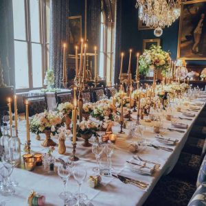 Eastnor Castle Wedding Florist Elegant Gold Candlelight Long Tables