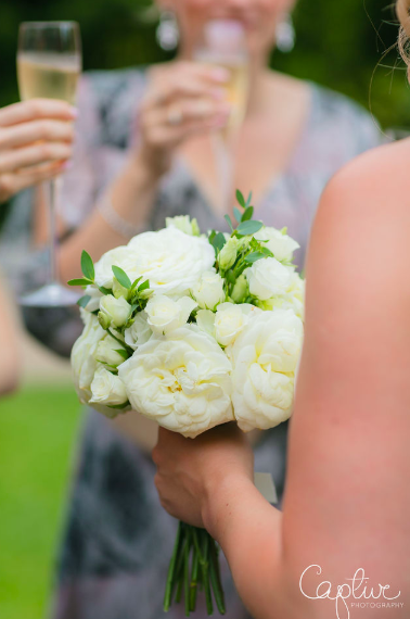 Elegant white rose wedding bouquets