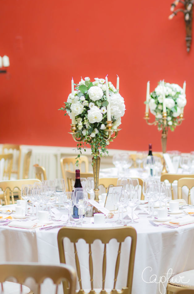 Hampton Court House Wedding Centrepieces Tall Candelabra Gold with white roses