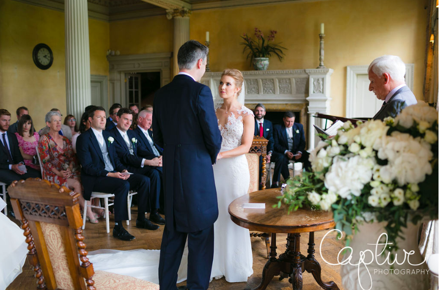 Hampton Court House wedding flowers urns ceremony