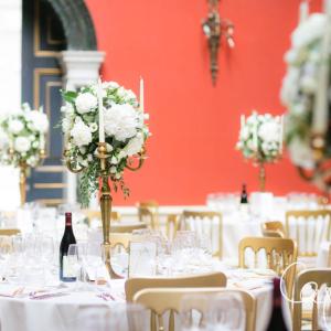 Tall wedding centrepieces candelabra white roses foliage
