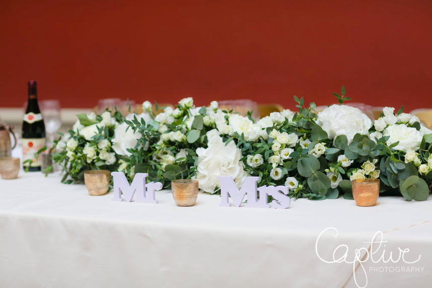 Traditional elegant wedding top table flowers