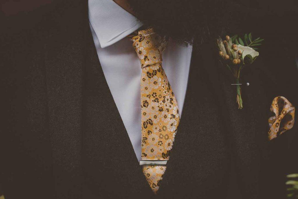 yellow tie wedding button holes
